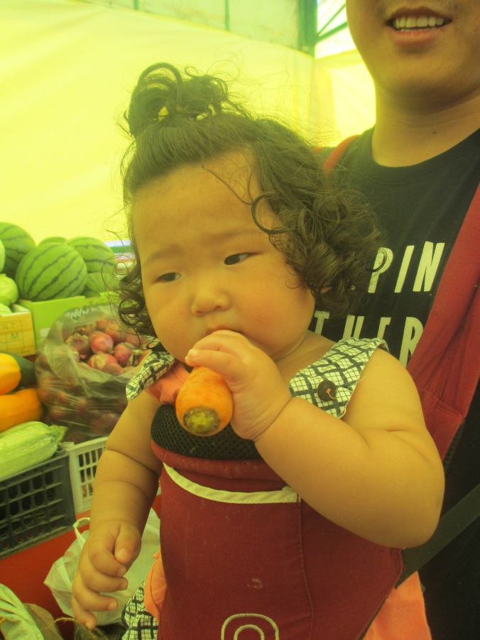 Baby enjoying Farmer's Market